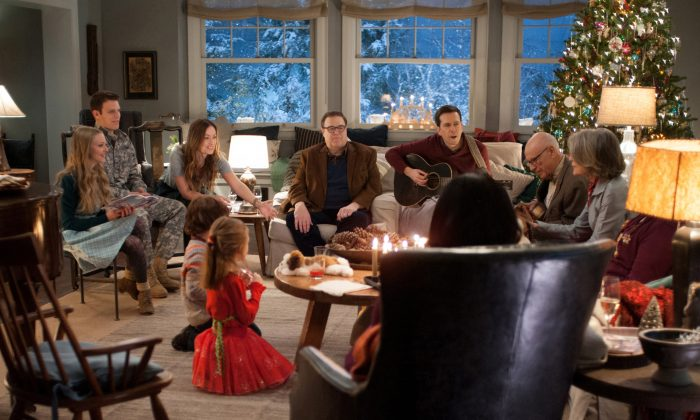 "This photo provided by CBS Films and Lionsgate shows, Amanda Seyfried, from left, as Ruby, Jake Lacy, as Joe, Olivia Wilde, as Eleanor, Maxwell Simkins, as Bo, Blake Baumgartner, as Madison, John Goodman, as Sam, Ed Helms, as Hank, Alan Arkin, as Bucky, Diane Keaton as Charlotte, and Alex Borstein (back to camera), in ""Love the Coopers,"" released by CBS Films and Lionsgate. (Suzanne Tenner/CBS Films/Lionsgate via AP)"