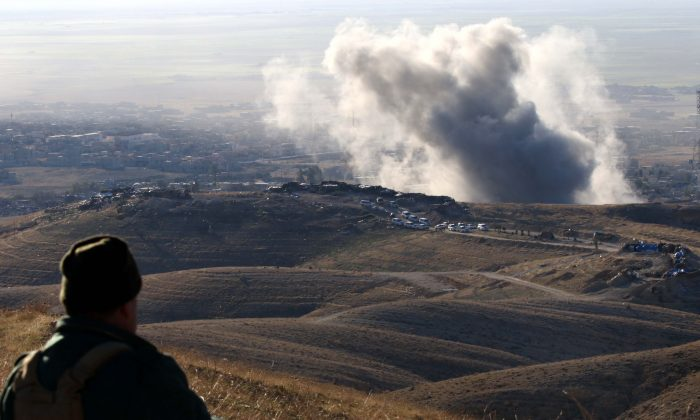 Heavy smoke billows from the northern Iraqi town of Sinjar, Mosul province, during an operation by Iraqi Kurdish forces backed by US-led strikes on November 12, 2015, to retake the town from the Islamic State group and cut a key supply line to Syria. (SAFIN HAMED/AFP/Getty Images)