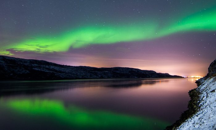The Aurora Borealis or Northern Lights illuminate the night sky near the town of Kirkenes in northern Norway on Nov. 12, 2015.	(Jonathan Nackstrand/Getty Images)