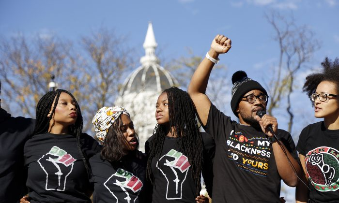 Concerned Student 1950, led by University of Missouri graduate student Jonathan Butler, second from right, speaks following the announcement that University of Missouri System President Tim Wolfe would resign Monday, Nov. 9, 2015, in Columbia, Mo. (Sarah Bell/Missourian via AP)