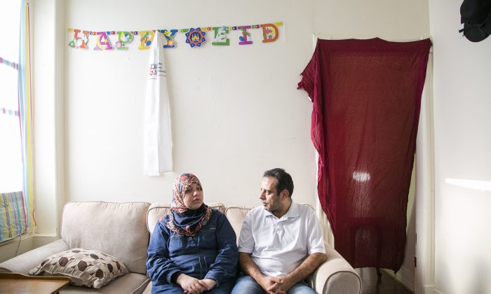 Syrian refugees Hussam Al Roustom and his wife Suha in their home in Jersey City, New Jersey, on Nov. 9, 2015. They left Homs, Syria in 2013 with their two small children. (Samira Bouaou/Epoch Times)