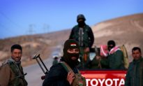 Kurdish Forces Recapture Militant-Held Towns in Iraq, Syria