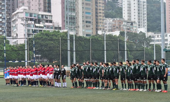 Portugal (green) and Russia (red) line up before the start of their match in the 2015 Cup of Nations in Hong Kong on Friday Nov 13, 2015. (Bill Cox/Epoch Times)