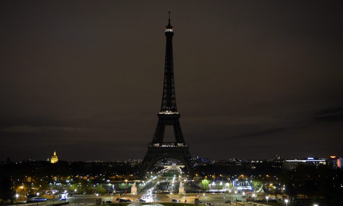 The Eiffel Tower with its lights turned off following the deadly attacks in Paris on Nov. 14, 2015. Islamic State jihadists claimed a series of coordinated attacks by gunmen and suicide bombers in Paris that killed at least 129 people in scenes of carnage at a concert hall, restaurants and the national stadium. (Alain Jocard/AFP/Getty Images)