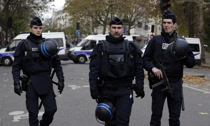 Policemen patrol near the Bataclan theatre in the 11th district of Paris on Nov. 14, 2015, after a series of attacks on the city resulting in the deaths of at least 127 individuals. (Kenzo Tribouillard/AFP/Getty Images)
