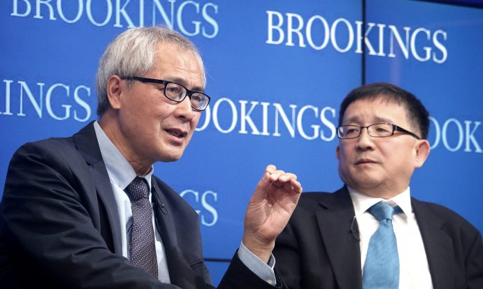 He Huaihong (L), professor of philosophy at Peking University in Beijing, and Cheng Li, director, John L. Thornton China Center, The Brookings Institution, discuss moral decay and ethical awakening in China, at Brookings on Nov. 6. (Gary Feuerberg/Epoch Times)