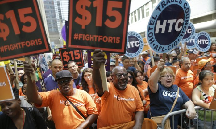 Activists rally for a $15 minimum wage in New York on July 22, 2015. (AP Photo/Mary Altaffer)