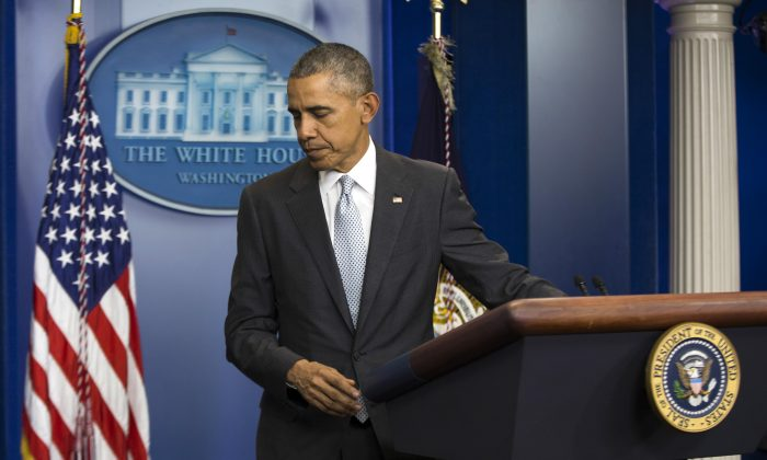 "President Barack Obama walks from the podium after speaking about attacks in Paris from the briefing room of the White House, on Nov. 13, 2015, in Washington, D.C. Obama is calling the attacks on Paris an ""outrageous attempt to terrorize innocent civilians"" and vows to do whatever it takes to help bring the perpetrators to justice. (AP Photo/Evan Vucci)"