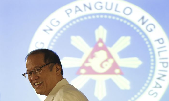 Philippine President Benigno Aquino III smiles after a press conference at the Malacanang presidential palace in Manila, Philippines, on Sept. 17, 2015. The anti-corruption campaign of Philippine President Benigno Aquino III has led to the arrest of a string of top officials, including three senators, a former national police chief and even his predecessor. But many prominent people arrested have evaded conviction and jail time, and some experts say Aquino's campaign has had little wider impact, raising questions about his effectiveness in tackling this scourge that has plagued the country for generations. (AP Photo/Aaron Favila)