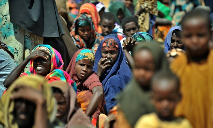 Newly arrived Somali refugees wait outside a registration center at the Dadaab refugee camp in eastern Kenya   (Tony Karumba/AFP/Getty Images)