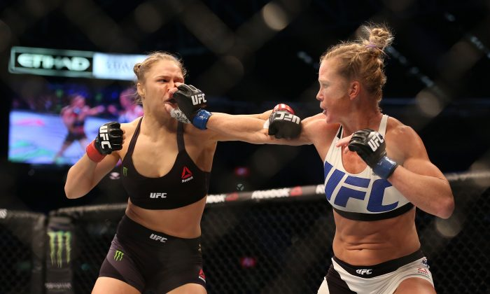 Ronda Rousey and Holly Holm in their UFC women's bantamweight championship bout during the UFC 193 event at Etihad Stadium on November 15, 2015 in Melbourne, Australia. (Getty Images)