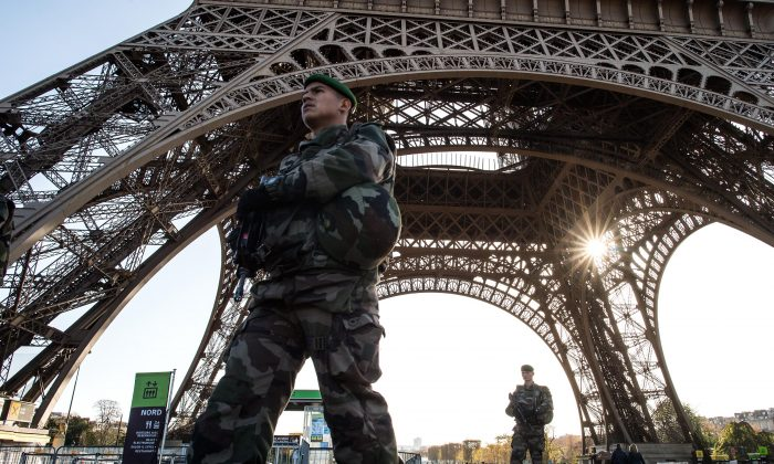 A French soldier stands guard at Eiffel Tower in Paris, France, on Nov. 15, 2015. (David Ramos/Getty Images)