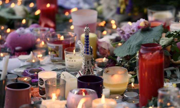 Flowers, candles and a toy Eiffel Tower are pictured at a makeshift memorial near the Bataclan concert hall in Paris on Nov. 15, 2015, two days after a series of deadly attacks. (Miguel Medina/AFP/Getty Images)