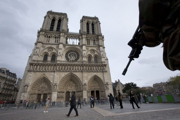 A soldier patrols at Notre Dame Cathedral in Paris, Monday, Nov. 16, 2015. France is urging its European partners to move swiftly to boost intelligence sharing, fight arms trafficking and terror financing, and strengthen border security in the wake of the Paris attacks. (AP Photo/Peter Dejong)