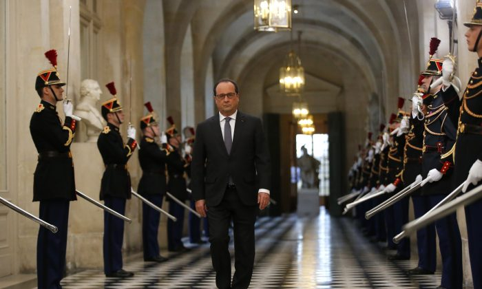 French President Francois Hollande arrives to deliver a speech at the Versailles castle, west of Paris, Monday, Nov.16, 2015. (AP Photo/Michel Euler)