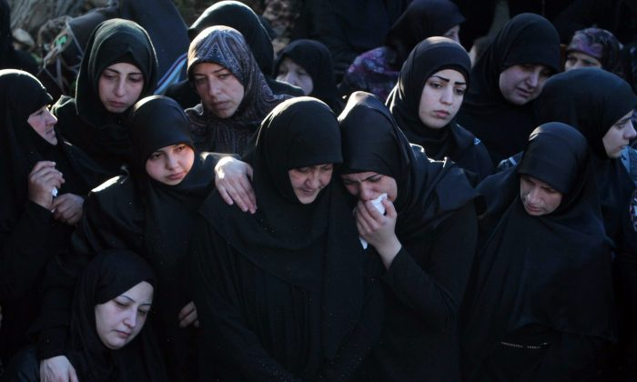 Relatives and friends of Hezbollah member Adel Termos, who was killed in Thursday's twin suicide bombings, mourn during his funeral procession in the southern Lebanese village of Tallousa, Lebanon, on Nov. 13, 2015. (AP Photo/Mohammed Zaatari)