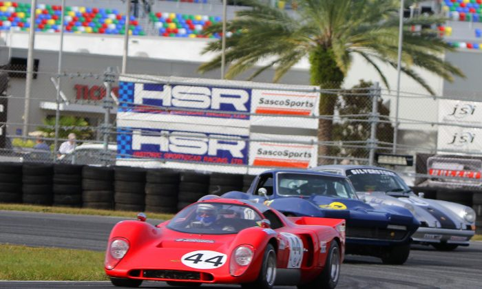 This is what makes the Classic 24 so amazing: tight competition between a wide variety of strikingly beautiful, historically important cars. Here Gray Gregory and Randy Buck's #44 1971 Chevron B16 leads the #17 1964 Corvette of Brian and Spencer Trenery and the #76 1972 Porsche 911 of Tom O'Callaghan and Bruce Ellsworth around Turn Three in the infield of Daytona International Speedway during the first Group A race during the HSR Classic 24, Nov. 14. (Chris Jasurek/Epoch Times)