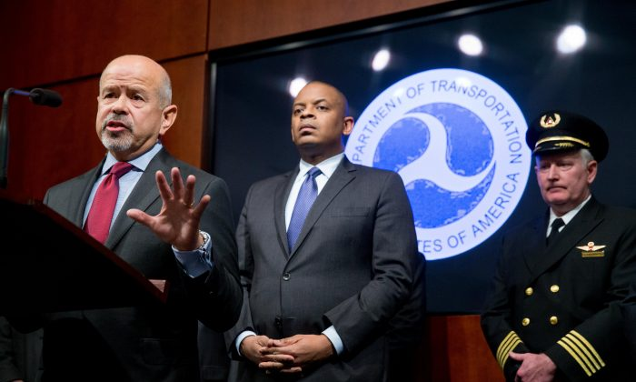 FAA Administrator Michael Huerta (L) accompanied by Transportation Secretary Anthony Foxx (C), and Airline Pilots Association President Tim Canoll (R) answers questions at a news conference at the Department of Transportation in Washington, D.C., on Oct. 19, 2015, where the creation of a task force to develop recommendations for a registration process for Unmanned Aircraft Systems (UAS) was announced. (AP Photo/Andrew Harnik)