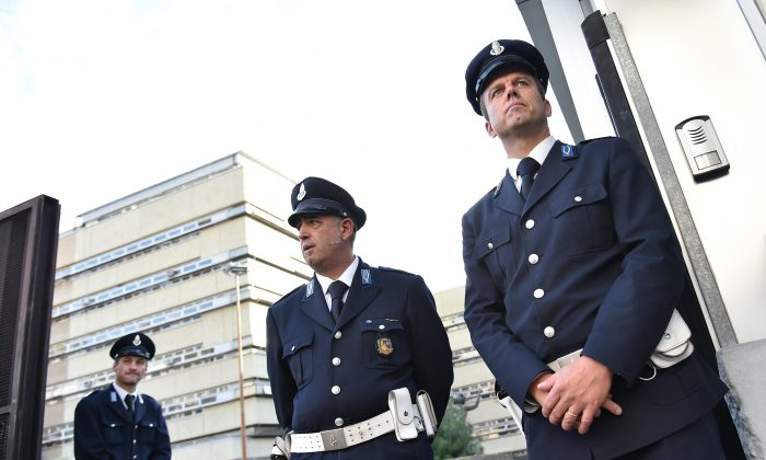 Guards stand at the entrance to Rome's criminal court on Nov. 5, 2015, on the opening day of the Mafia Capitale trial, a case related to the alleged infiltration of City Hall by a mafia network. (Alberto Pizzoli/AFP/Getty Images)