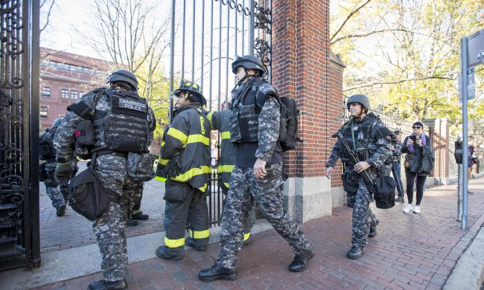 CAMBRIDGE, MA - NOVEMBER 16: Cambridge Police SWAT team members arrive at Harvard Yard following a bomb threat that was made on campus on November 16, 2015 in Cambridge, Massachusetts. Multiple buildings were evacuated and the Harvard Yard was shut down so that authorities could search. (Photo by Scott Eisen/Getty Images)