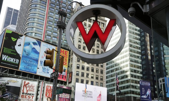 The logo for the W Hotel, owned by Starwood Hotels & Resorts Worldwide, is seen in New York's Times Square on July 31, 2013. Marriott International announced Monday, Nov. 16, 2015, it is buying rival hotel chain Starwood for $12.2 billion in a deal that will secure its position as the world's largest hotelier. (AP Photo/Mark Lennihan)