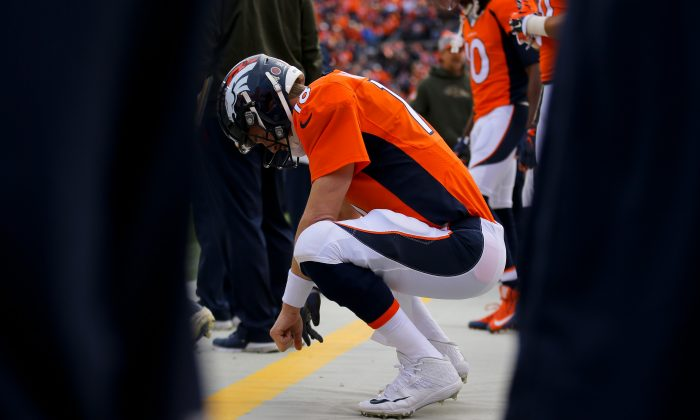 Peyton Manning of the Denver Broncos is having his worst NFL season ever, though a foot injury seems to be the culprit. (Justin Edmonds/Getty Images)