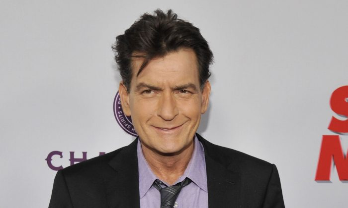 "In this April 11, 2013 file photo, Charlie Sheen, a cast member in ""Scary Movie V,"" poses at the Los Angeles premiere of the film at the Cinerama Dome in Los Angeles. (Chris Pizzello/Invision/AP, file)"