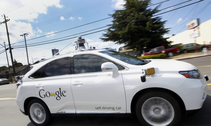 Google's self-driving Lexus car in Mountain View, Calif. (AP Photo/Tony Avelar)