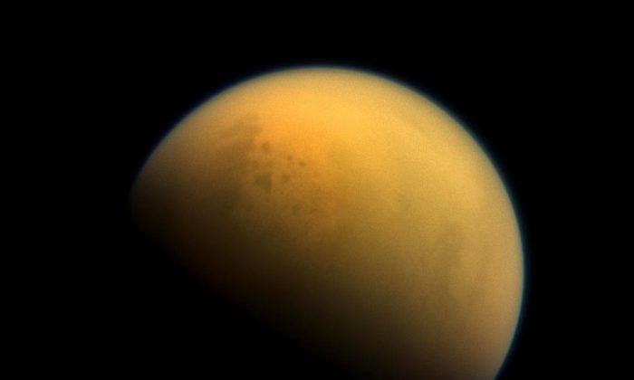 "Astronomers often think of Earth-like exoplanets as ""pale blue dots, but with this haze, Earth would have been a 'pale orange dot',"" says Giada Arney. Above, an image of Saturn's haze-shrouded moon Titan taken by the Cassini spacecraft. (Credit: NASA)"