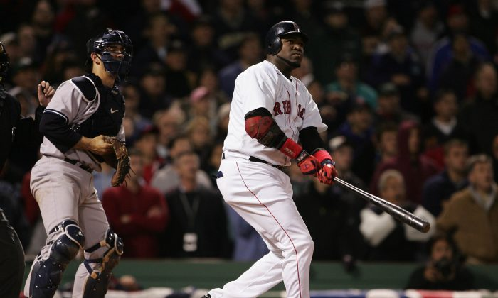 David Ortiz (R) was at his best when it mattered most, leading the Red Sox to three World Series titles. (Doug Pensinger/Getty Images)
