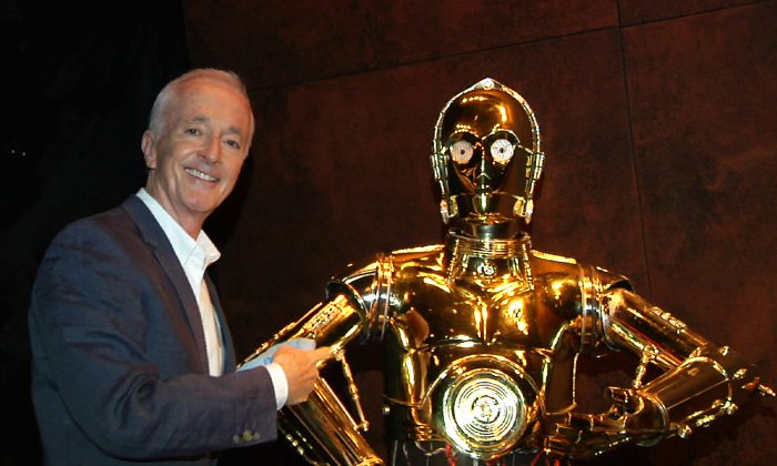 "In this image taken from video, actor Anthony Daniels, who portrays C-3PO in the ""Star Wars"" films, appears with his robot counterpart at a preview for the ""Star Wars and the Power of Costume"" exhibition at Discovery Times Square Museum on Wednesday, Nov. 11, 2015. (AP Photo/Bruce Barton)"