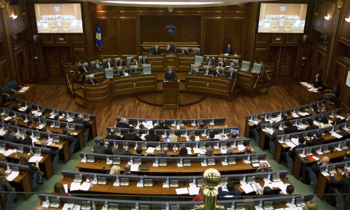 Kosovo's Prime Minister Hashim Thaci (C) addresses lawmakers during a parliament session in Pristina on April 23, 2014. (STRINGER/AFP/Getty Images)