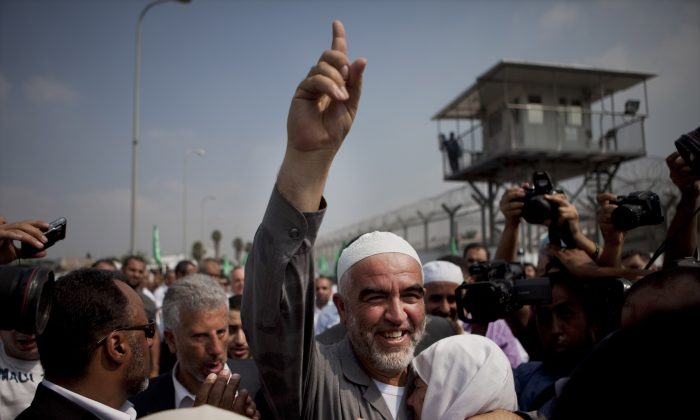 Sheik Raed Salah (C), the leader of the northern branch of the Islamic Movement in Israel, arrives at Ayalon Prison to serve his sentence at the central Israeli town of Ramle on July 25, 2010. Israel outlawed an Islamist party accused of inciting violence among the country's Arab citizens, the government announced on Nov. 17, 2015, as part of its measures to stamp out a two month-long deadly escalation. (AP Photo/Oded Balilty)