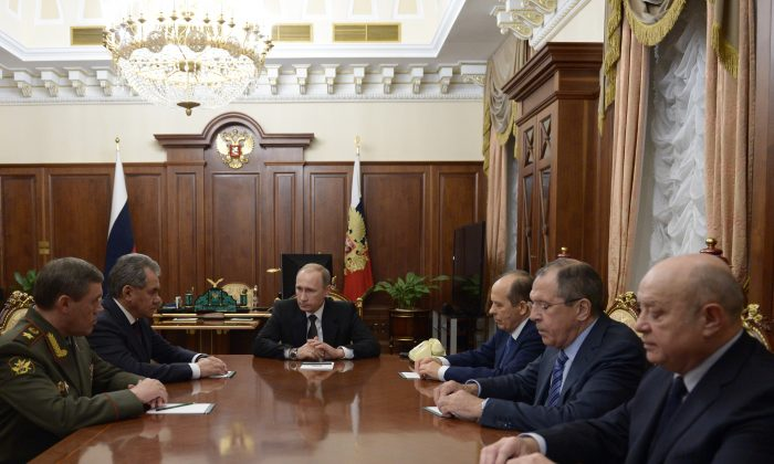 (L-R) Head of General Staff, Gen. Valery Gerasimov, Defense Minister Sergei Shoigu, Russian President Vladimir Putin, Federal Security Service (FSB) head Alexander Bortnikov, Foreign Minister Sergey Lavrov, and Foreign Intelligence Service head Mikhail Fradkov at a meeting on the Russian plane crash in Egypt, in Moscow's Kremlin, Russia, on Nov. 17, 2015. The head of Russia's FSB security service says the crash of the passenger plane in Egypt was the result of a 'terrorist' act. Alexander Bortnikov told President Vladimir Putin on Tuesday that a homemade explosive device blew up on the plane. (Alexei Nikolsky/Sputnik via AP)