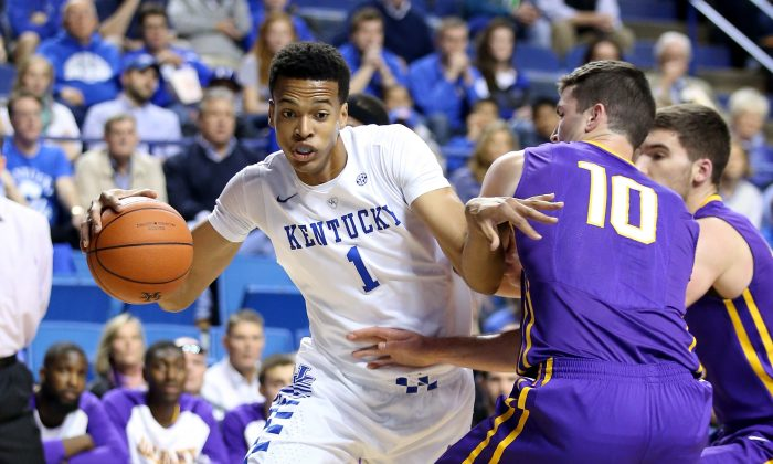 Five-star center Skal Labissiere (L) of the Kentucky Wildcats might be in the pros right now, if not for the NBA's minimum age requirement. (Andy Lyons/Getty Images)