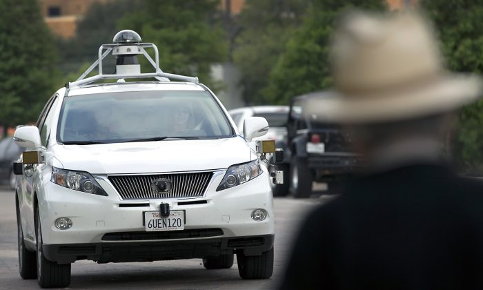A Google self-driving SUV is viewed in Austin, Texas, in 2015. Hustling to bring cars that drive themselves to a road near you, Google finds itself somewhere that has frustrated many before: Waiting for help from California's department of motor vehicles. Over the summer, Google expanded its road testing from Silicon Valley to Texas, where state law would not prohibit cars without pedals and a wheel. (Ralph Barrera/Austin American-Statesman via AP)