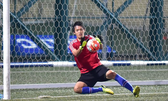 HKU70's goalkeeper saves during their 2-1 defeat by Club Colts in the Yau Yee League first division match at Sports Road on Sunday Nov 15, 2015. (Bill Cox/Epoch Times)