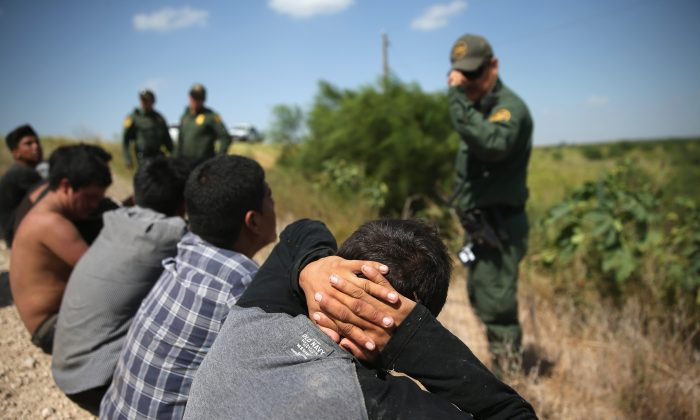 Border Patrol agents detain illegal immigrants after they crossed the border from Mexico into the United States in McAllen, Texas, on Aug. 7, 2015. The state's Rio Grande Valley corridor is the busiest illegal border crossing into the United States. Border security and immigration have become major issues in the U.S. presidential campaigns. (John Moore/Getty Images)