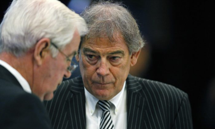 New Zealander David Howman (R), the director general of the World Anti-Doping Agency (WADA), talks with Craig Reedie, WADA president, during a break in a meeting at the Broadmoor Hotel in Colorado Springs, Wednesday, Nov. 18, 2015. Leaders from the World Anti-Doping Agency met Wednesday to decide whether to ban Russia's anti-doping operation in the wake of the report about corruption in the country's track and anti-doping programs. (AP Photo/Brennan Linsley)