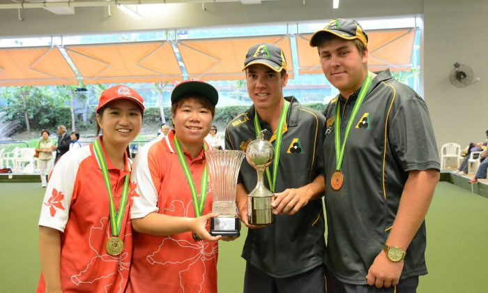 Hong Kong Youth Team member Amy Choi (from left) and Vivian Yip, along with Australian Nathan Pedersen and Corey Wedlock proudly display their pairs trophy after prevailing victorious in their respective pairs finals at the Hong Kong International Classic on Sunday Nov 15. (Stephanie Worth)