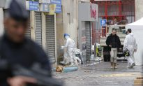 Officials: Suspected Paris Mastermind, Cousin Died in Raid