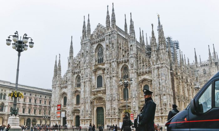"Carabinieri officers patrols the Duomo gothic cathedral in Milan, Italy, Thursday, Nov. 19, 2015. The State Department is warning that St. Peter's Basilica in Rome, Milan's cathedral and La Scala opera house, as well as ""general venues"" like churches, synagogues, restaurants, theaters and hotels have been identified as ""potential targets"" in those two cities for terrorist attacks. (AP Photo/Luca Bruno)"
