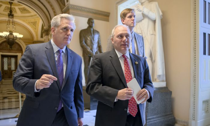 House Majority Leader Kevin McCarthy (R-Calif.), left, and House Majority Whip Steve Scalise (R-La.), stride from the House chamber on Capitol Hill in Washington on Nov. 18, 2015. (AP Photo/J. Scott Applewhite)