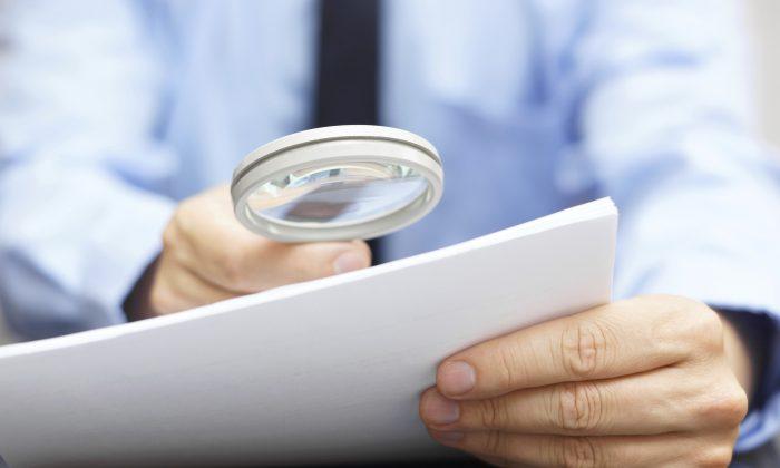 Photo showing a man investigating important documents. (BernardaSv/iStock)