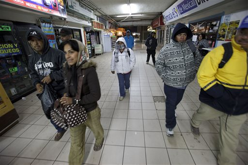 In this March 7, 2012 file photo, people make their way towards the border to cross in Mexicali, Mexico. More Mexicans are leaving the United States than coming to the country, marking a reversal to one of the most significant immigration trends in U.S. history, according to a study published Thursday, Nov. 19, 2015. (AP Photo/Gregory Bull)