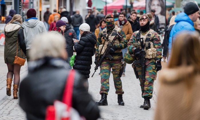 Soldiers from the Belgian army patrol in the picturesque Grand Place in Brussels on Friday, Nov. 20, 2015.  Salah Abdeslam, a French national who lived in Molenbeek, Belgium, is currently the subject of an international manhunt after the Paris attacks. Security has been stepped up in parts of Belgium as a precaution. (AP Photo/Geert Vanden Wijngaert)