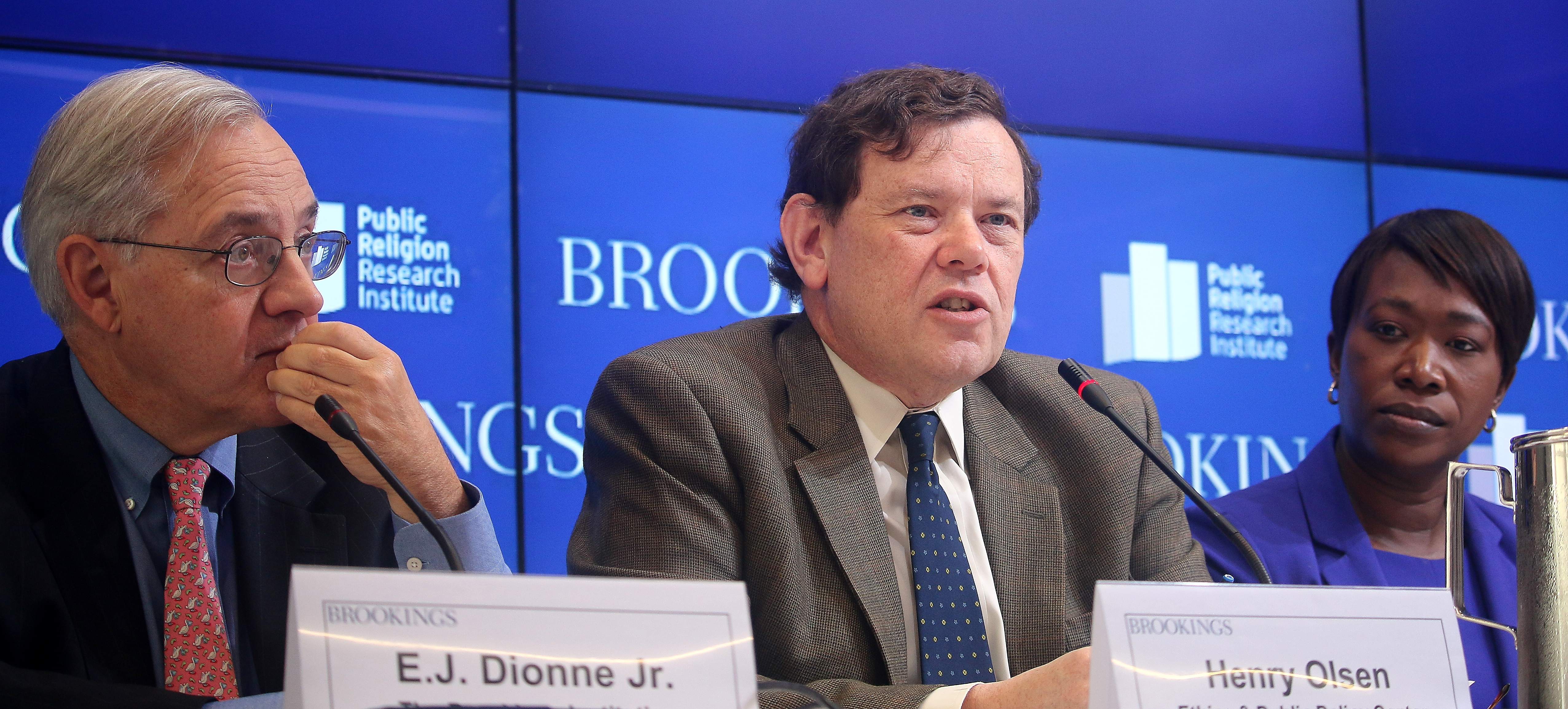 Henry Olsen (C), senior fellow, Ethics & Public Policy Center, speaks on the findings from 2015 American Values Survey, as co-moderator E.J. Dionne, Jr. (L), who is senior fellow, at The Brookings Institution, and Joy Reid, who is national correspondent for MSNBC, listen. The event took place at Brookings on Nov. 17. (Gary Feuerberg/Epoch Times)