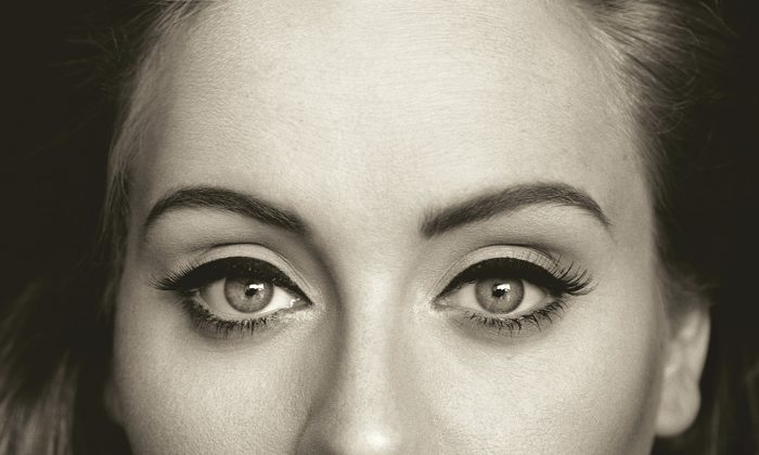 "This CD cover image released by Columbia Records shows, ""25,"" the latest release by Adele. The singer's hotly anticipated album is out Friday, Nov. 20, 2015. (Columbia Records via AP)"