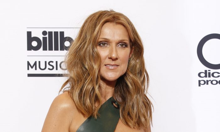 "Celine Dion at the Billboard Music Awards in Las Vegas on May 17, 2015. Dion will honor the victims of the attacks in Paris at the American Music Awards on Sunday, Nov. 22, 2015. ABC and dick clark productions say that Dion will perform a rendition of Edith Piaf's ""Hymne à L'Amour"" in French at the ceremony to pay tribute to those affected by last week's attacks. (Eric Jamison/Invision via AP)"