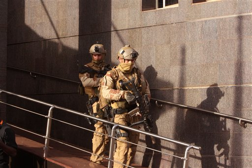 Soldiers leave the Radisson Blu hotel, after assisting Mali soldiers during an attack by gunmen on the hotel in Bamako, Mali, Friday, Nov. 20, 2015. (AP Photo/Harouna Traore)